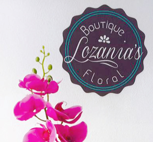 <span>Lozania's Boutique Floral</span><i>→</i>